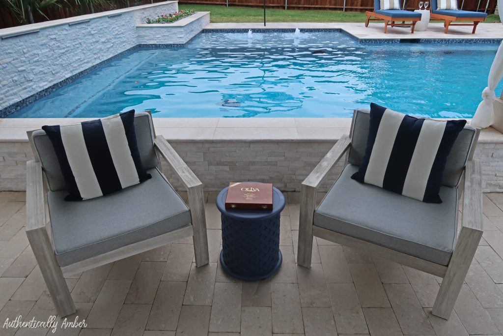 authentically amber backyard pool renovation staycation cabana chairs