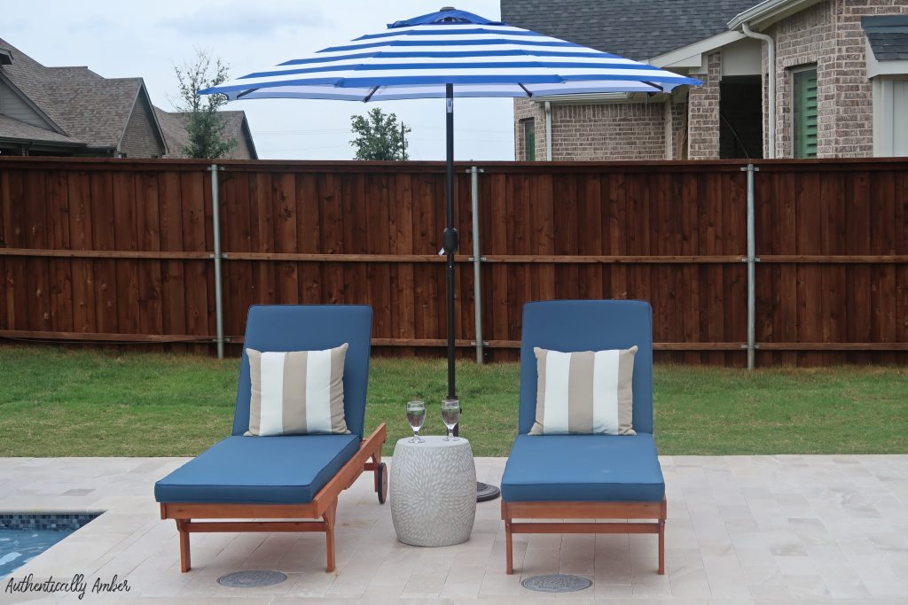 authentically amber backyard pool renovation staycation lounge chairs